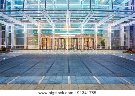 Empty floor near modern building facade
