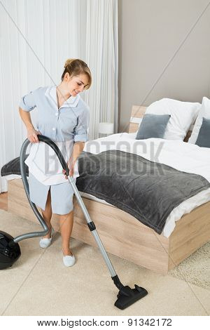 Female Housekeeper With Vacuum Cleaner