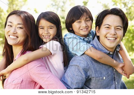 Asian family head and shoulders portrait outdoors