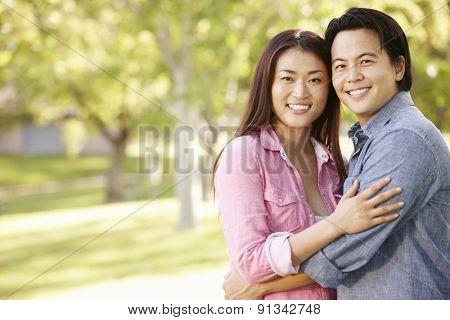 Romantic portrait Asian couple in park