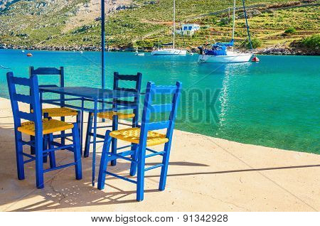 Wooden blue chairs in Greek restaurant, Greece