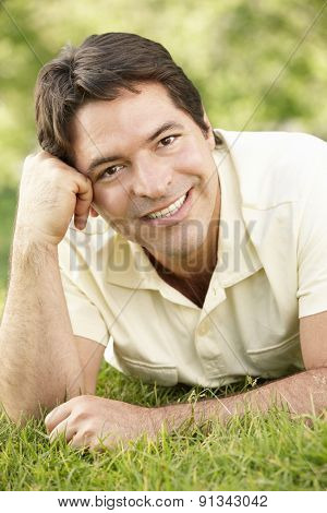 Young Hispanic Man Relaxing In Park