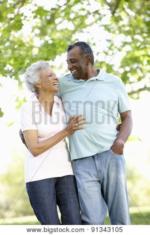 Romantic Senior African American Couple Walking In Park