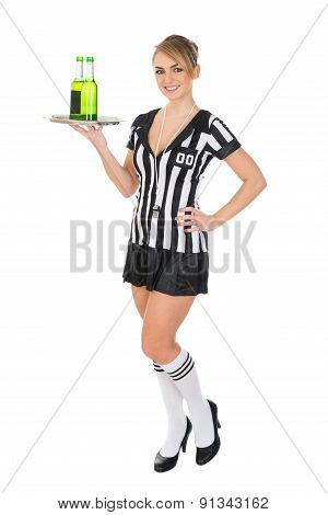 Female Referee Carrying Drinks