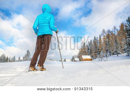Young woman standing on traill in winter scenery