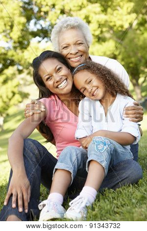 African American Grandmother, Mother And Daughter Relaxing In Park