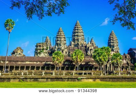 Angkor Wat temple with palms and lake,  Cambodia