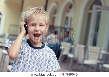 Boy Speaks To A Mobile Phone in a shop.