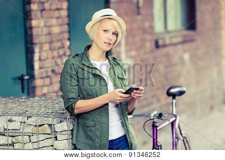 Hipster Woman Portrait With Phone And Bike