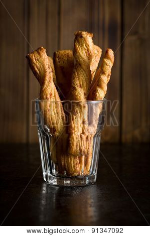 bread sticks with cheese in glass