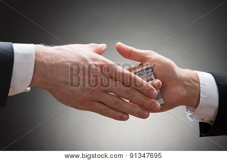 Businessman Hand Giving Bribe