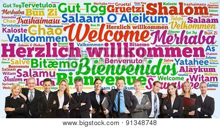 Successful business team saying welcome in tag cloud with many languages