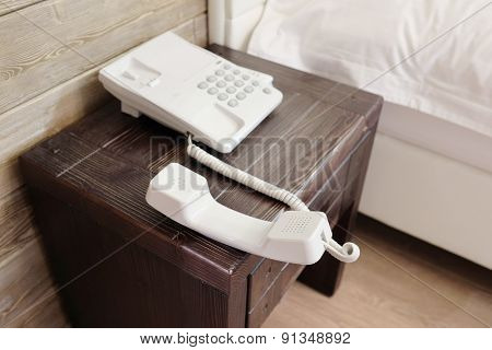 Phone with the hanging tube in hotel room