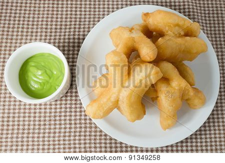 Delicious Deep Fried Doughstick With Green Custard Dip