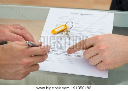 Person Signing Lease Agreement