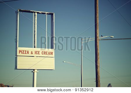 vintage signboard with blue sky, soft focus