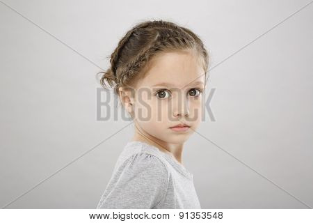 Five years girl with braided hair
