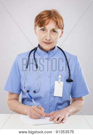 Sixty years woman doctor at work