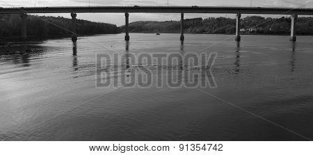 Boat Below A Bridge