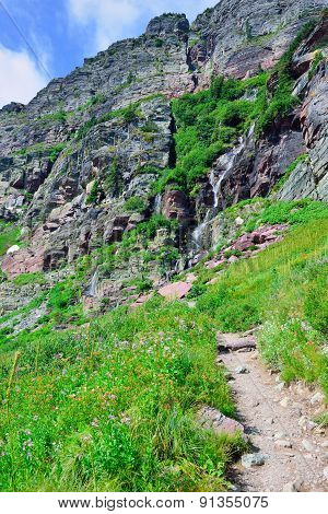 High Alpine Trail By The Waterfall In Glacier National Park, Montana