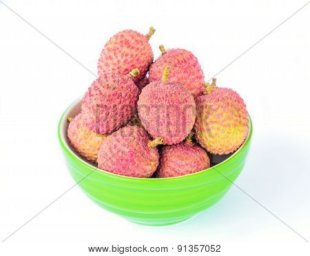 Ripe lychee fruit in green bowl against white background