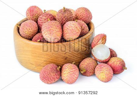 Ripe Lychee Fruit In Wooden Bowl Against White Background