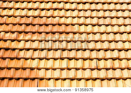 bright sunlight lit roof top tiles background