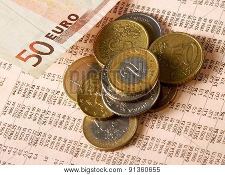 Money: euro coins and bills close up