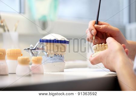 hands of dentist working on a dental implant