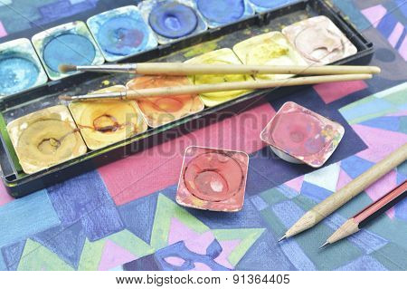 Messy Used Water Color Paint Box And Paintbrush