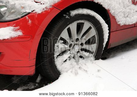 Car wheel stuck in snow