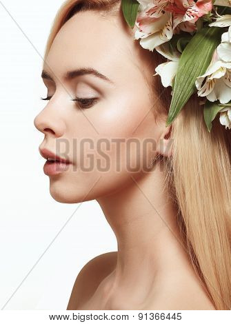 Young Girl With Flowers In Her Hair