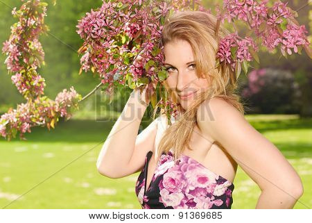 Portrait Of A Girl Under A Cherry Blossom Tree