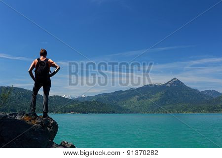 Hiker Is Standing On A Rock