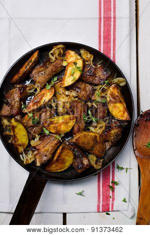 Ribs Fried With Potato On A Frying Pan