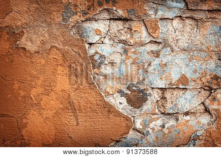 Background of colorful brick wall texture. brickwork. Peeling paint. Pattern of rustic material