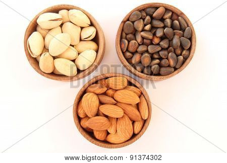 Three Types Of Nuts In A Round Wooden Form
