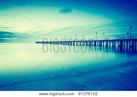 Vintage Photo Of Beautiful Seascape With Wooden Pier.