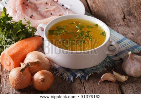 Chicken Broth And Ingredients On The Table Close-up. Horizontal