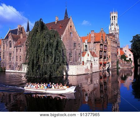 Pleasure boat on canal, Bruges.