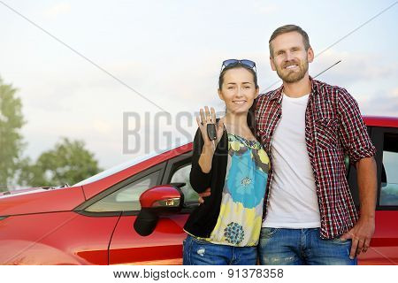 Couple Near The Red Car.