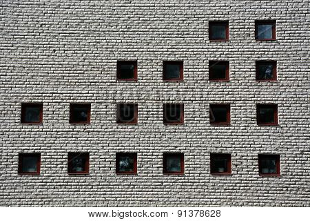 Architectural Background- Greybrick Wall And Small Windows