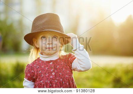 Portrait Of Cute Little Girl In Hat. Spring.