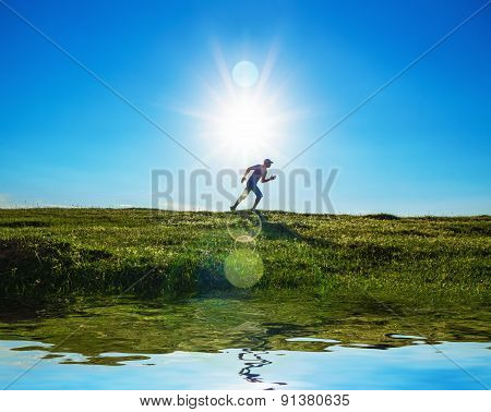 Activity - Vitality Man Running On Field - Grass. Healthy Lifestyle