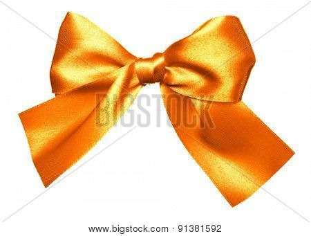 golden bow made from silk isolated