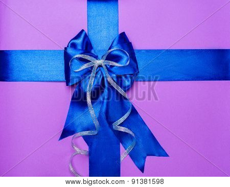 blue bow made from silk on purple