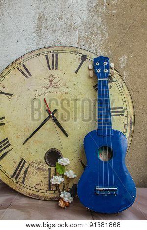 Ukulele And Classical Clock