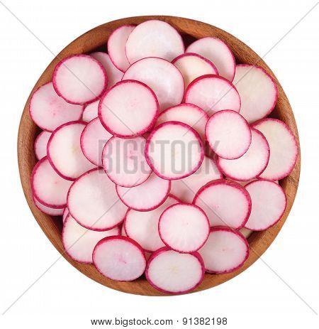 Red Sliced Radish In A Wooden Bowl On A White