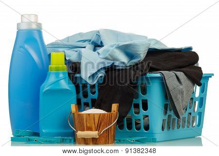 Detergents and clothes in baske