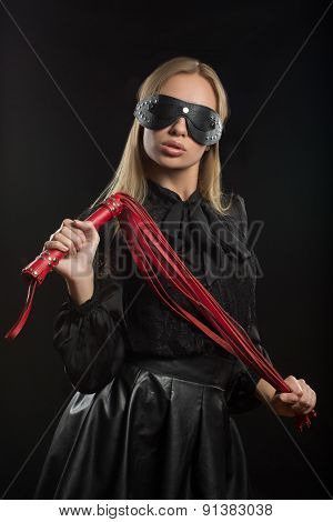 Portrait of young beautiful woman in blindfold